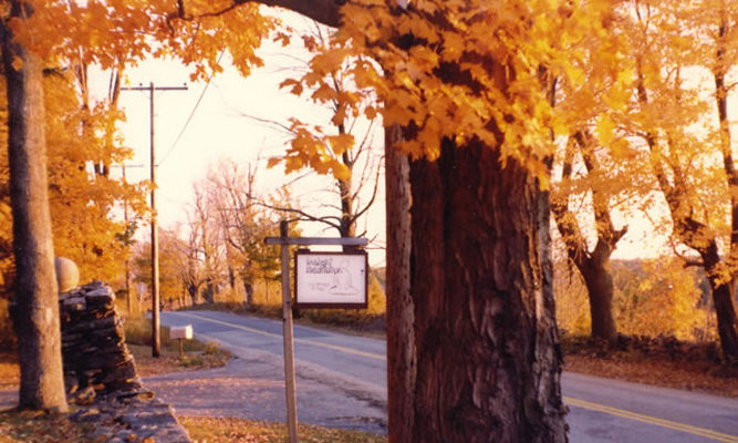 1977 - The original sign amidst fall colors.