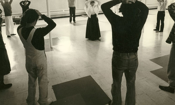 Ruth Denison (center of circle) studied in Burma in the early 1960s and is shown here leading a mindful movement session.