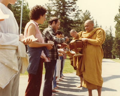 Thai meditation master Ven. Ajahn Chah on alms round at IMS during his 1979 visit.
