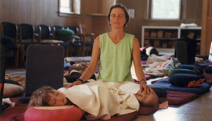 Mother and daughter share a meditative moment.